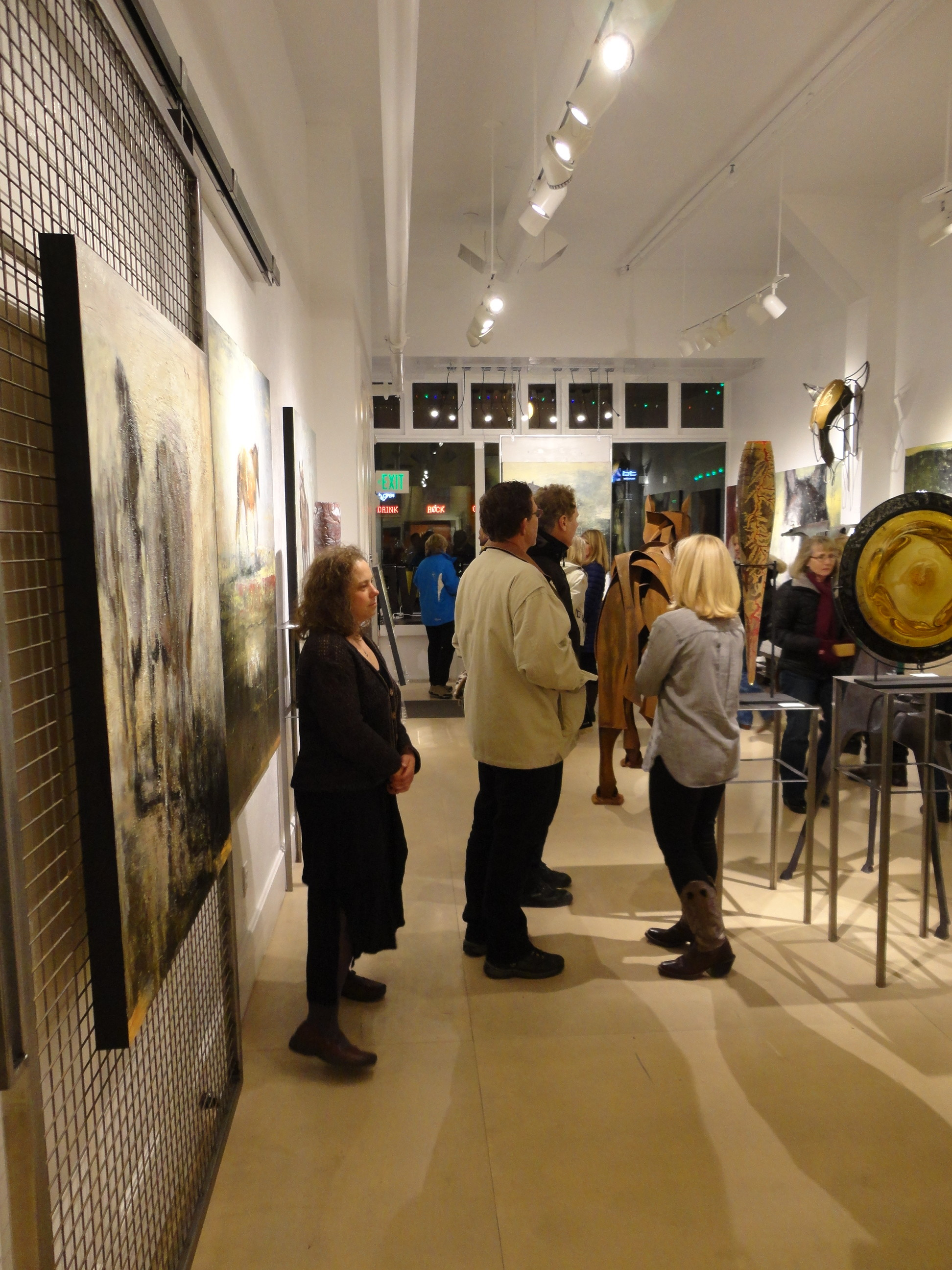 Visitors at Gallery MAR take their time to browse...