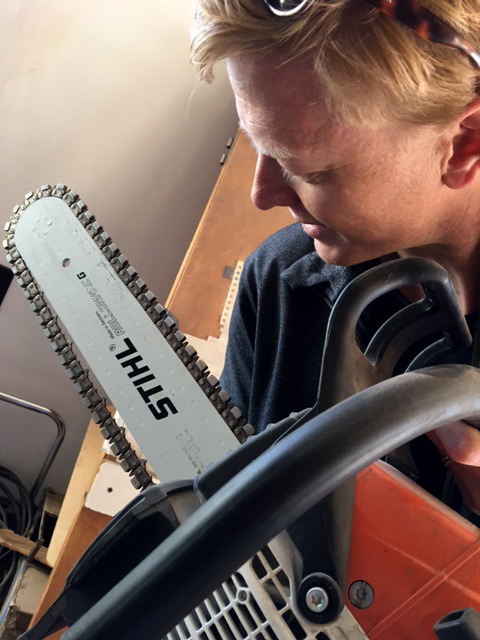 Inspecting a new tool: a diamond-edged chain saw
