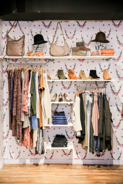 Clothing store interior with shoes and clothing