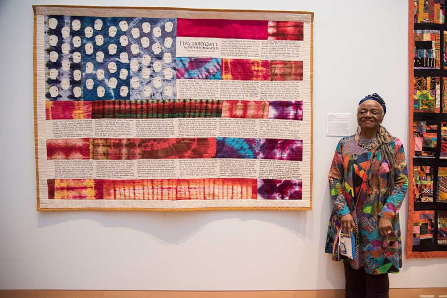 Renowned artist Faith Ringgold with her quilt
