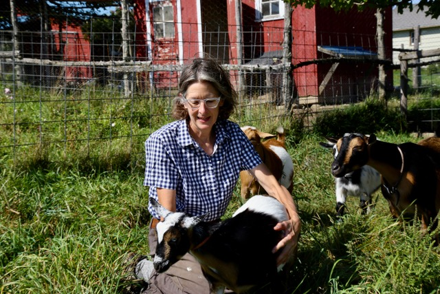 Ms. Murphy with her with goats