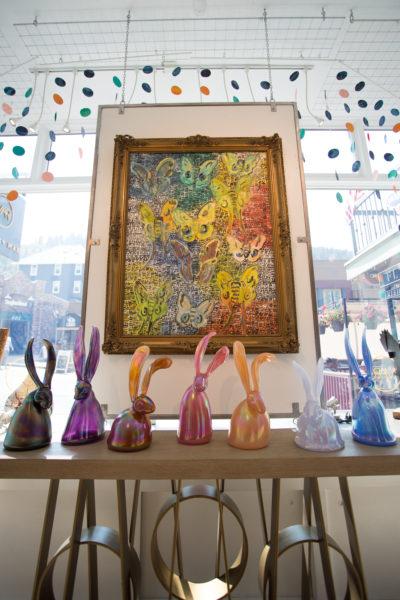"Glass bunnies rest under an oil painting by Hunt Slonem, ""Polyphemus,"" 43"" x 32"""